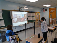 Student trying to get a good look at the smart board thumbnail183467